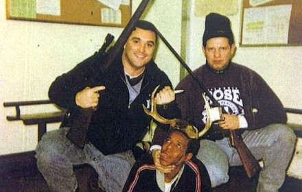 Timothy McDermott and Jerome Finnigan, are armed with rifles and kneel over an unidentified African-American drug suspect who they allegedly splayed to look like hunters' bounty.