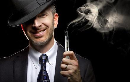 male smoking a vapor cigarette as an alternative to tobacco