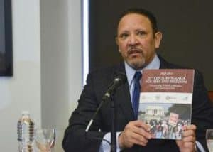 Marc Morial, the president and CEO of the National Urban League talks about the 21st Century Agenda for Jobs and Freedom during a meeting with presidential hopeful Hillary Clinton. (Freddie Allen/AMG/NNPA)