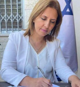 Israeli Environmental Protection Minister Gila Gamliel signs an amendment banning fur sales to the fashion industry. (Courtesy of Environmental Protection Ministry)